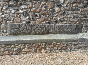 Porch stone at Little Shelford church.
