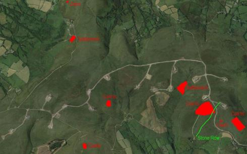 Google Map image of Mynydd y Betws showing the impact of the new wind farm on this rich archaeological landscape. The scheduled archaeology is highlighted in red and the position of the probable stone row shown in green.