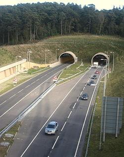 Something like this? It's not the tunnel that matters but where the approach roads are built