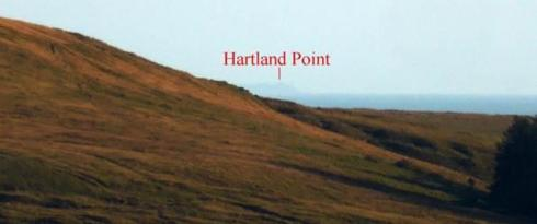 7. Very little sea is now apparent between the headland and nearby hill, but the alignment is still clearly focused on Hartland Point.