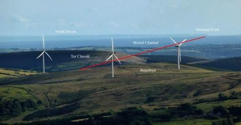 View from the Black Mountain illustrating the wider landscape within which Bancbryn should be viewed. The red line denotes the line of sight between the cairn at the top of the row and Hartland Point.