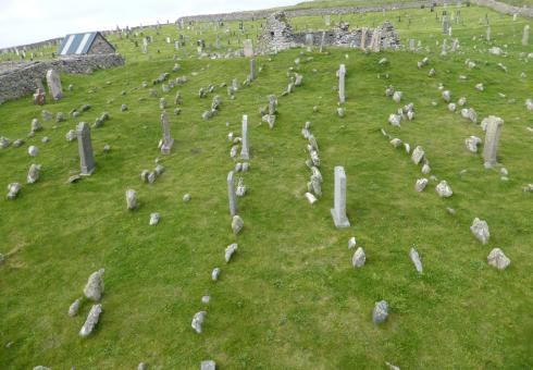 Grave markers and chapel (Teampull Eion) within the historic cemetery at Bragar, Isle of Lewis