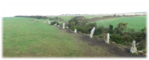 Nine Maidens stone alignment leading up a gentle hill towards The Fiddler from which there is a view of Hartland Point. The orientation of the alignment is directly towards Hartland Point.
