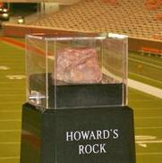 Chipping a bit off a decorative rock in a US football stadium:
