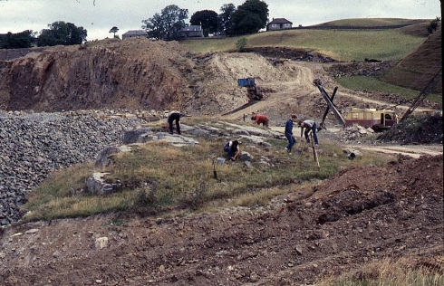 Illus. 4. General view of Greenland no. 1 being de-turfed in 1984 with the quarry in the background.