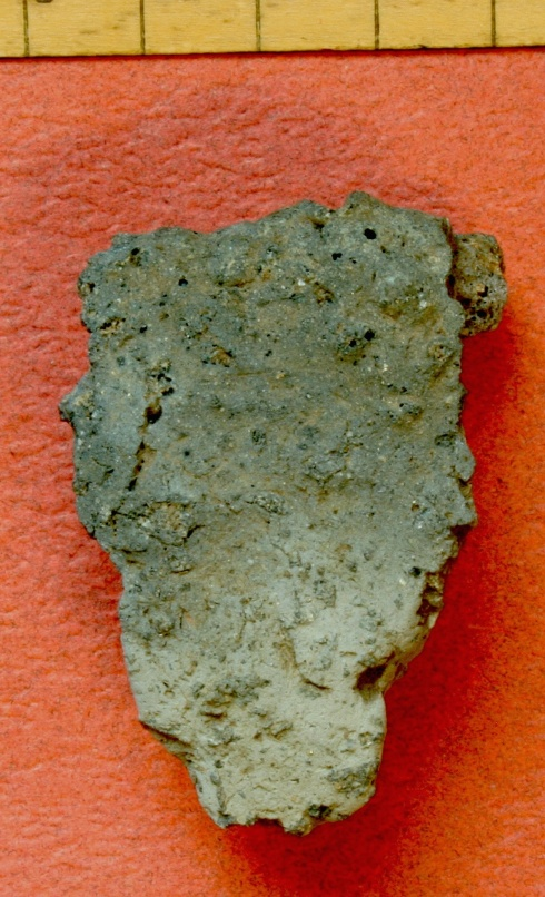 Illus. 6: rim sherd of Dunagoil ware from the midden under the rampart on the southern edge of Fort 2. It has been severely burned and vitrified into a coke-like substance, presumably when the timber-framed dun was destroyed by fire.