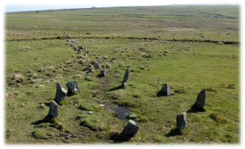 The cairn at the top of the stone alignment. Note the way in which the row's orientation shifts to ensure that it reaches the kerbed cairn. The orthostats denoting the cairn are larger than those used to build the row.