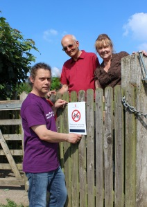 (L to R): HOOOH Community Group volunteers Neil Phillips, Rob Baur and Katie Jones install a 'No Bikes' sign as their first task working with English Heritage.