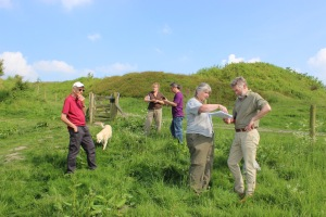 Volunteers, with Maggie Rowlands and Tim Malim in the foreground, get to grips with locations for taking monitoring photography on the hillfort.